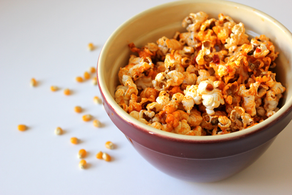sriracha popcorn | via http://withach.com